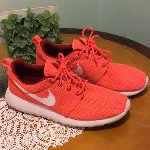 Nike orange and white shoes